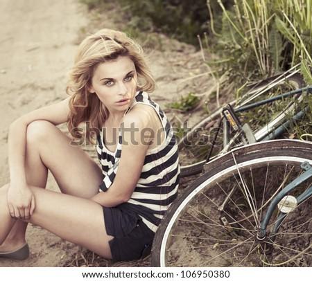 beautiful girl in the summer around Bike - stock photo
