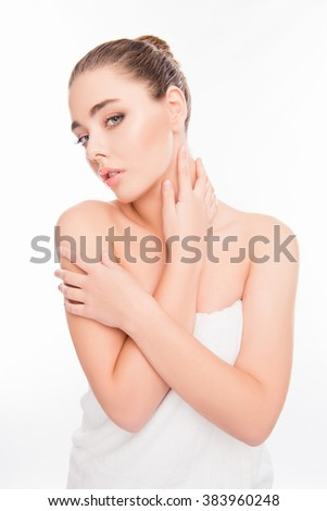 Beautiful girl in towel touching her neck after shower - stock photo