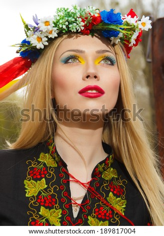 beautiful girl in Ukrainian national dress posing in the Park