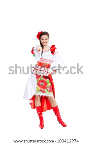 beautiful girl in ukrainian polish national traditional costume clothes point finger at you happy smile, portrait isolated over white background - stock photo