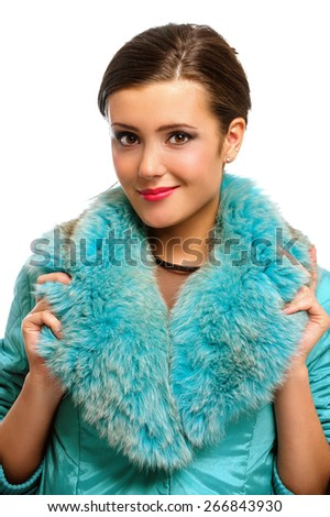 Beautiful girl in warm fur coat with fur, isolated on white background. - stock photo
