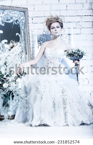 Beautiful Girl In White Dress The Image Of Snow Queen With A Crown On