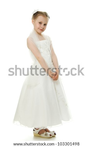 Beautiful girl in white dress on a white background. - stock photo