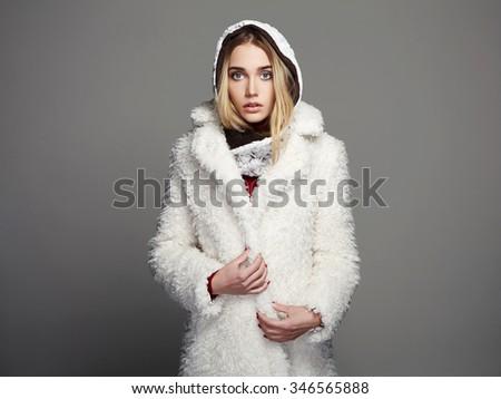 beautiful girl in white fur coat and hood. winter fashion beauty young woman  - stock photo