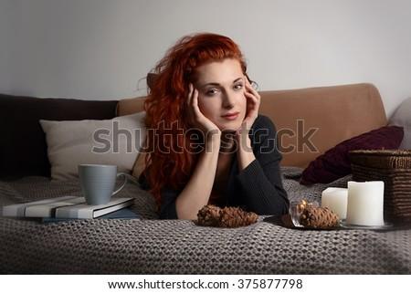 Beautiful girl in winter Home Interior - stock photo