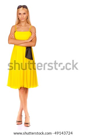 Beautiful girl in yellow dress to utmost, it is isolated on white background.