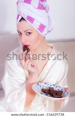 beautiful girl is eating chocolate cookies