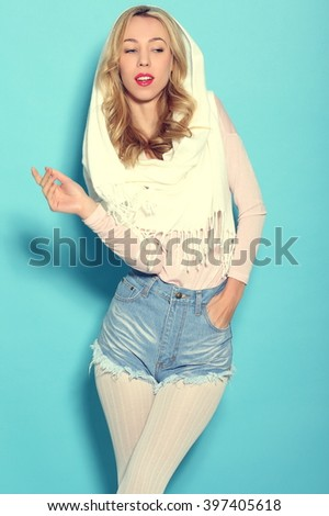 beautiful girl is in fashion style on a blue background - stock photo