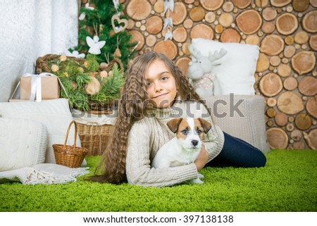 Beautiful girl is lying in the floor with dog. Girl with dog. children and pets - stock photo