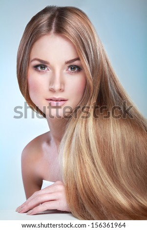 Beautiful girl, isolated on a blue background, emotions, cosmetics - stock photo