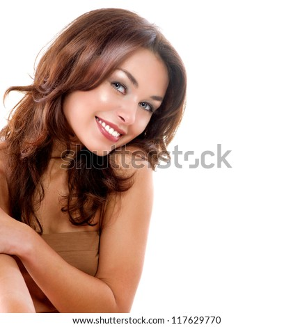 Beautiful Girl Isolated on a White Background. Perfect Skin. Beauty Face. Professional Makeup