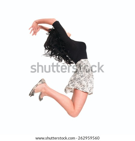 Beautiful girl jumping in the air