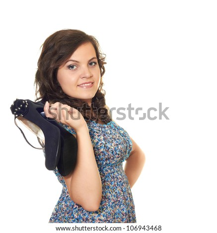 beautiful girl keeps her shoes in one hand isolated on white background