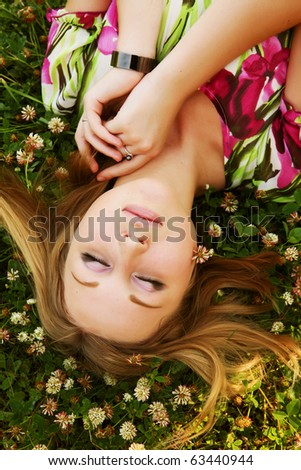 beautiful girl lays on a grass