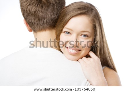 Beautiful girl leaning on boyfriend's shoulder, white background