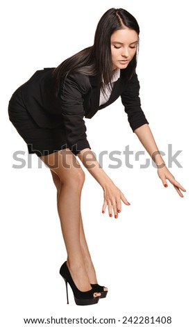 Beautiful girl leaning over stretched hands down - stock photo