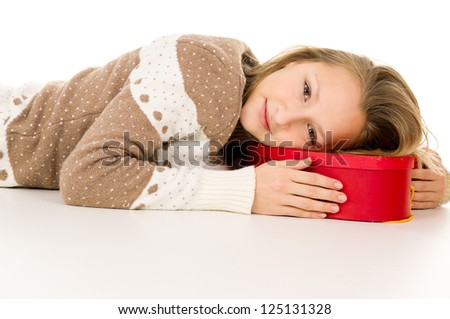 beautiful girl lies on a gift box isolated - stock photo