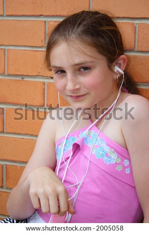 Beautiful girl listening to music player