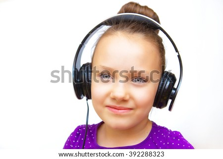 Beautiful girl listens to music on headphones