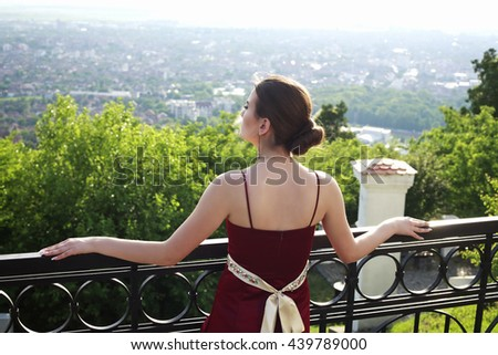 Beautiful girl looking at the panorama of the city - stock photo