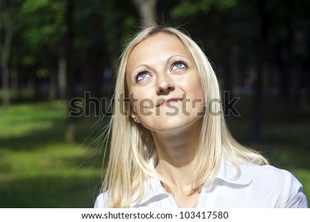 beautiful girl looking up at the nature - stock photo