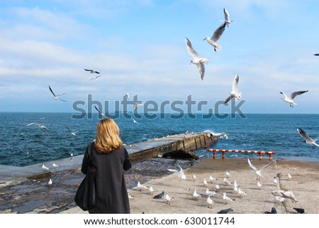 stock photo beautiful girl looks at the sea and the birds 630011744