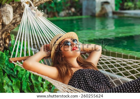 beautiful girl lying in a hammock - stock photo