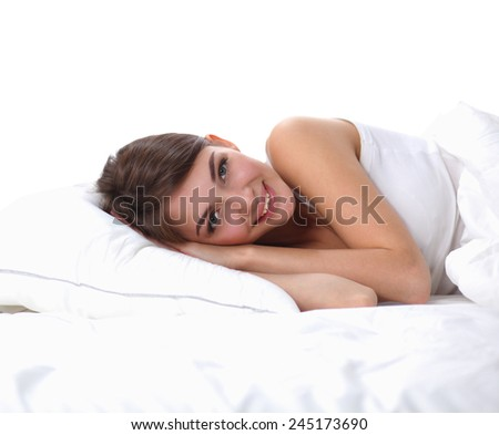 Beautiful girl lying in bedroom at early morning , isolated - stock photo