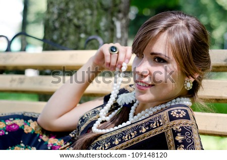 Beautiful girl lying on a bench