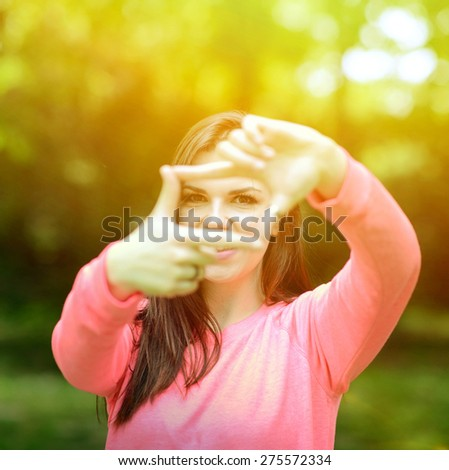 Beautiful girl making frame gesture - stock photo