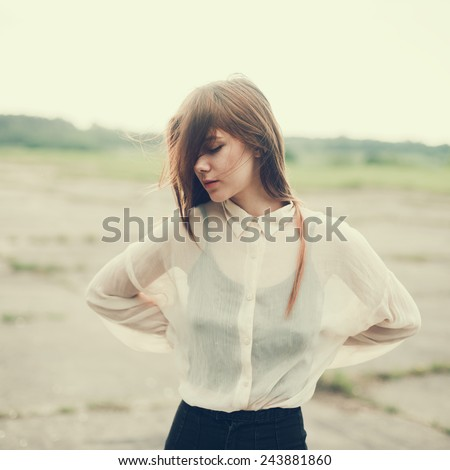 beautiful girl model in a blouse on the street - stock photo