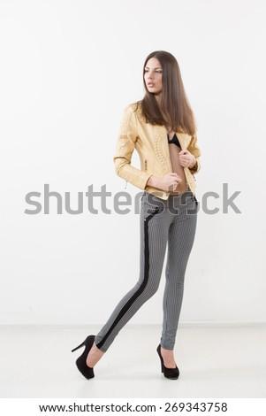 Beautiful girl model in beige jacket - stock photo