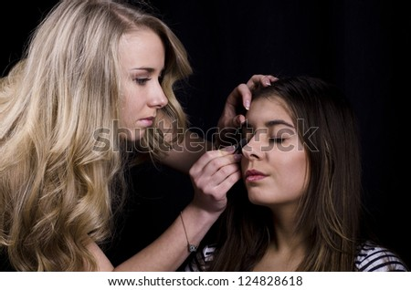 beautiful girl model, while make-up before shooting session - stock photo