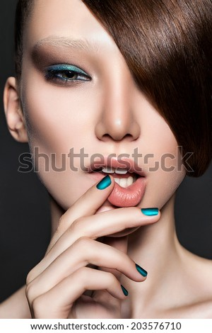 Beautiful girl model with perfect skin and color nails. Professional Make-up. - stock photo