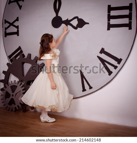 beautiful girl near a large clock in anticipation of the New Year. Tale, princess sets the clock - stock photo