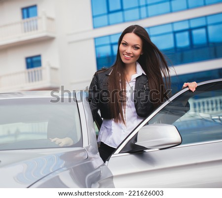 Beautiful girl near her car