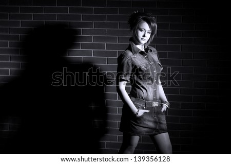 beautiful girl on a background a brick wall - stock photo