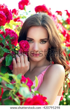 Beautiful girl on a background of roses
