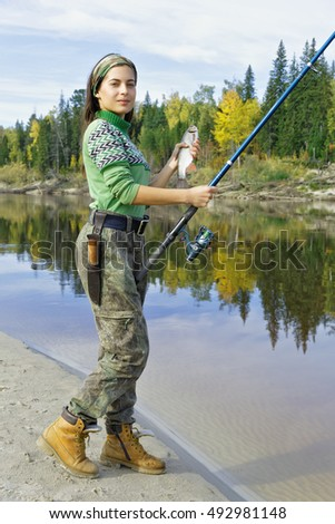 Beautiful girl on a fishing trip in the taiga, Siberia