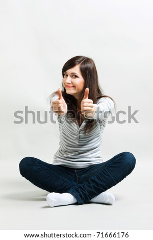 Beautiful girl on a gray background - stock photo