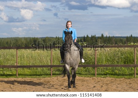 Beautiful girl on a horse - stock photo