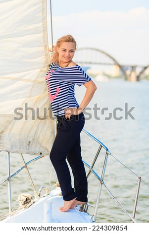 beautiful girl on a yacht sailing