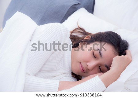 Beautiful girl on bed sleeping at home in the bedroom - Selective focus.