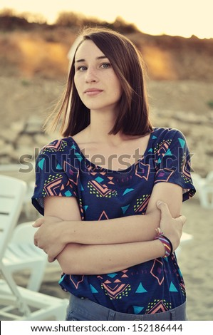 Beautiful girl on the beach during sunset