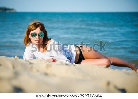 Beautiful Girl on The Beach. Travel and Vacation. Freedom Concept red-haired girl on the beach