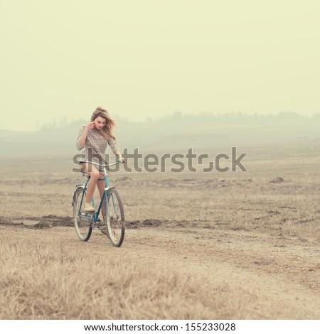 beautiful girl on the bike - stock photo