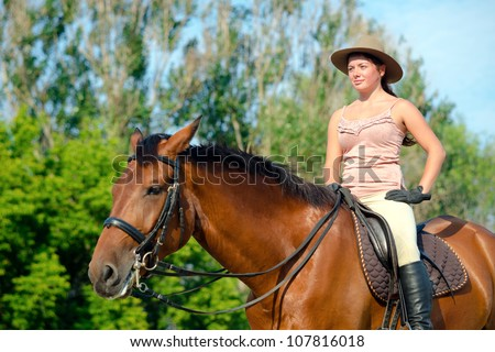 Beautiful girl on the farm with her horse. - stock photo