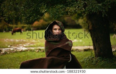"""beautiful girl on the field with cows and oak tree  (art photo project """"Joan of Arc"""") - stock photo"""