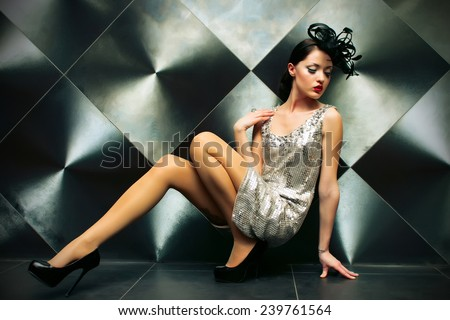 Beautiful girl on the floor, in a burlesque clothing - stock photo
