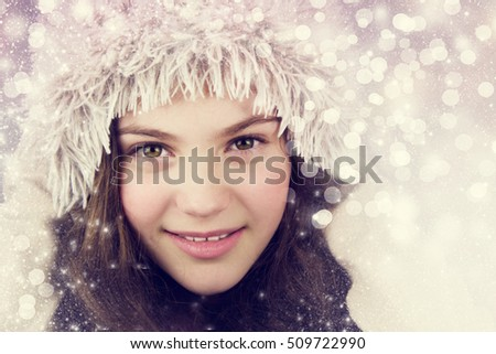 Beautiful girl on the winter background.